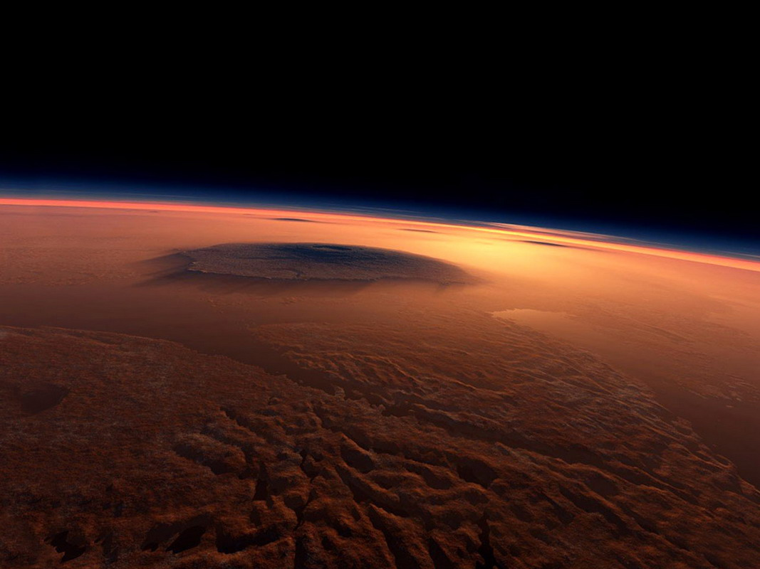 What appears from space to be minor rippling in a crimson landscape