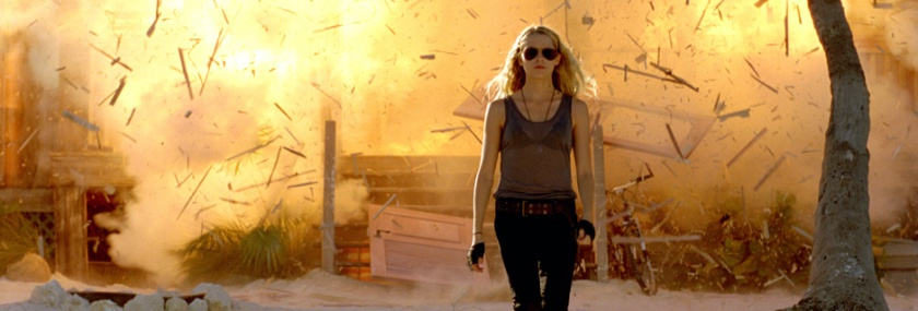 Sexy blonde walking away from explosion